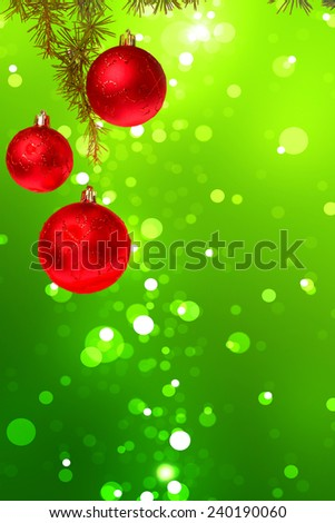 Christmas red balls with green fir tree on colorful green bokeh background. New Year greeting card. Xmas Decorations. Sparkles and bokeh. Shiny and glowing copyspace, place for text and advert. - stock photo