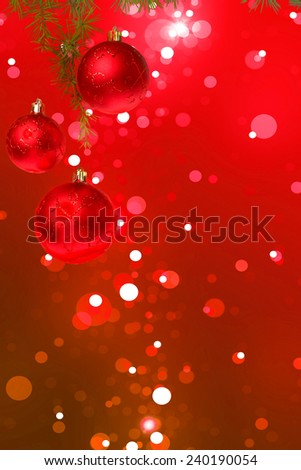 Christmas red balls with green fir tree on colorful red bokeh background. New Year greeting card. Xmas Decorations. Sparkles and bokeh. Shiny and glowing copyspace, place for text and advert. - stock photo