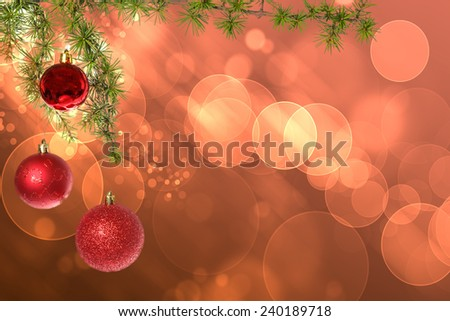 Christmas red balls with green fir tree on pink red bokeh background. New Year greeting card. Xmas Decorations. Sparkles and bokeh. Shiny and glowing copyspace, place for text and advert. - stock photo