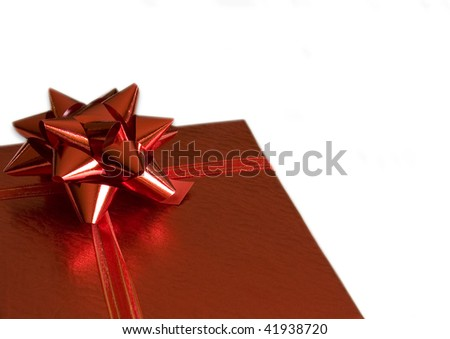 Christmas red gift box with bow, isolated on white