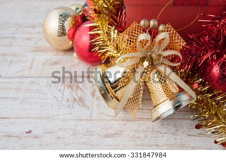 Christmas red gift box with decorations and color ball on vintage white wood background.copy space