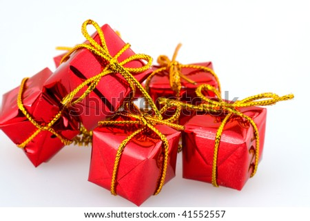 CHristmas red gift boxes with golden ribbon