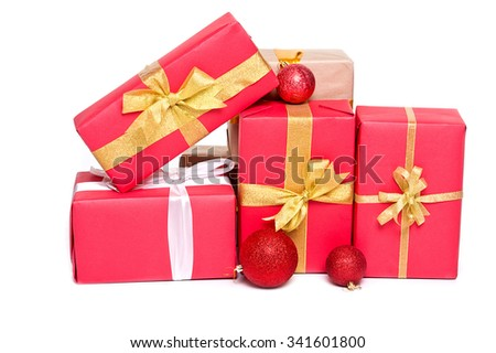 Christmas: red gift boxes with red christmas balls - stock photo
