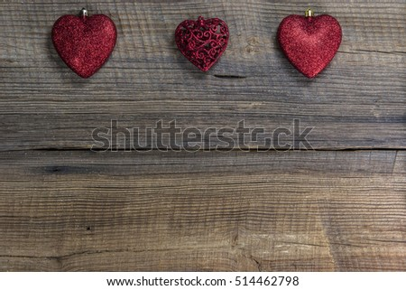 Christmas Red Hearts s on Wooden Board