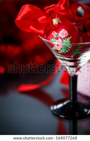 Christmas red hearts with red garland on a black background