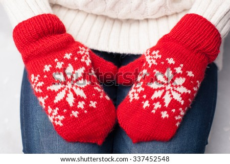 Christmas red knitted mitten with snowflake motives  - stock photo