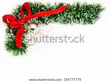 Christmas red ribbon with green ornaments and balls - stock photo