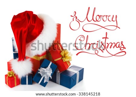 Christmas red santa hat with gifts and the words Merry Christmas isolated on white background - stock photo