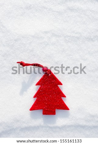 christmas red tree toys at snow background