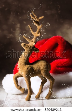 Christmas reindeer with santa hat in festive setting