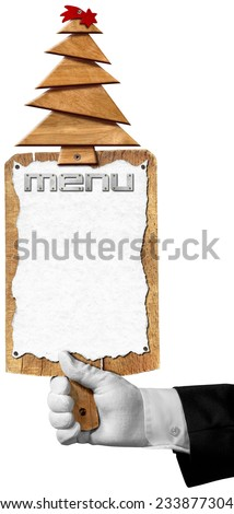 Christmas Restaurant Menu / Hand of waiter with white glove holding a old wooden cutting board with empty sheet of paper and wooden Christmas tree with red comet. Template for a Christmas food menu - stock photo