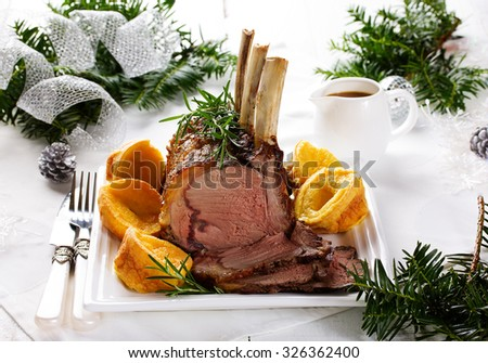 Christmas roast beef with Yorkshire pudding. Festive dinner. - stock photo