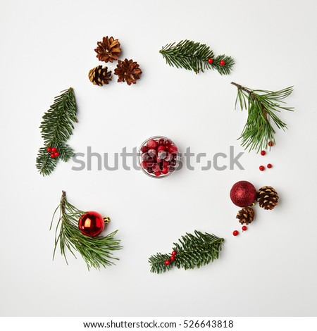 Christmas Round Frame from Natural Branches and Christmas Balls. �¡ranberry. Flat Lay