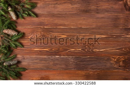 Christmas rustic background - vintage planked wood with Christmas fir tree and free text space. - stock photo