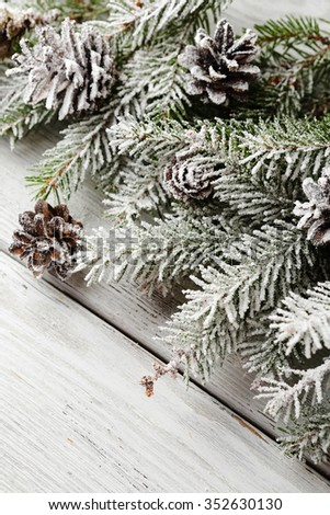 christmas rustic background with cone and branch, xmas - stock photo