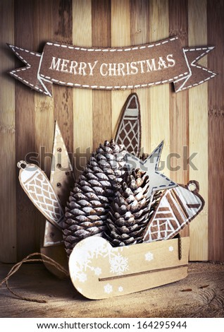 Christmas rustic decoration/Christmas decoration over wooden background/vintage paper christmas card - stock photo