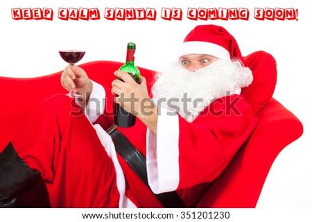 Christmas Santa Claus drinking red wine - stock photo