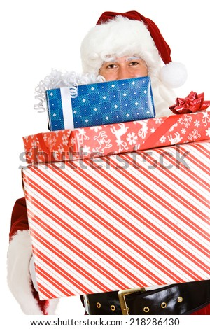 Christmas: Santa Claus Holds Up Stack Of Holiday Gifts