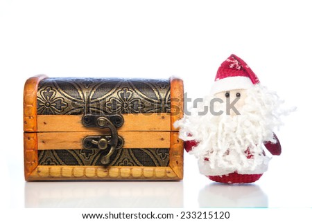 Christmas Santa Claus or Father Frost and wooden chest on white background with reflection