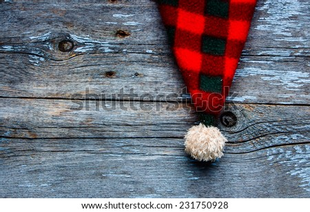 Christmas Santa Claus's Cap on Wooden Background, top view - stock photo