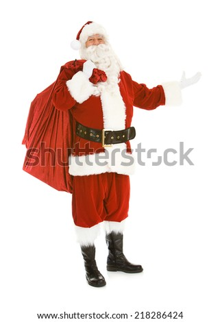 Christmas: Santa Claus Standing With Full Bag Of Gits - stock photo