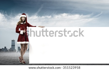 Christmas Santa girl with white blank banner - stock photo