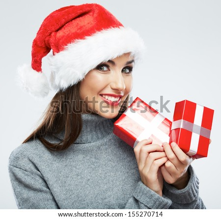 Christmas Santa hat isolated female portrait. Woman Santa. Christmas gift. Smiling happy girl on white background.