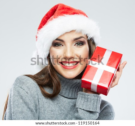 Christmas Santa hat isolated woman portrait hold christmas gift. Smiling happy girl on white background. Close up female portrait - stock photo
