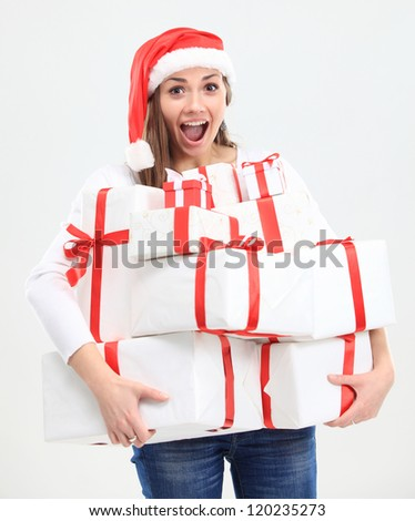 Christmas Santa hat isolated woman portrait hold christmas gift. Smiling happy girl on white background