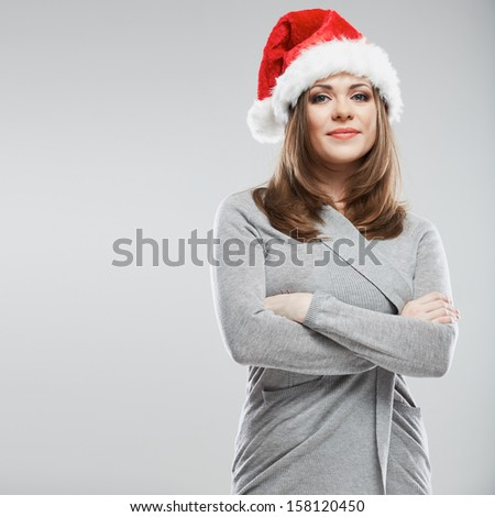 Christmas Santa hat isolated woman portrait. Smiling happy girl.