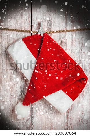 Christmas Santa hat on a wooden background - stock photo