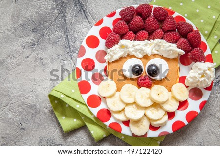 Christmas Santa pancake with raspberry and banana for kid breakfast