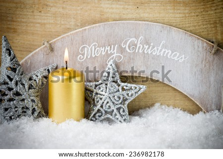 Christmas scene, candles with Christmas decor.