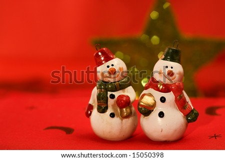 Christmas scene with decorated snowmen - stock photo