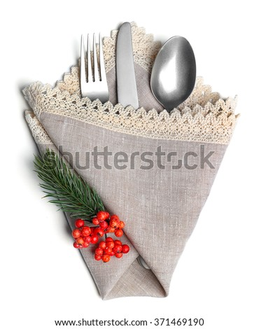 Christmas serving cutlery in a napkin, isolated on white - stock photo