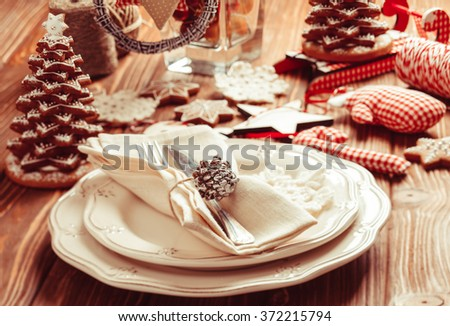 Christmas serving table in shabby chic style. Gingerbread decorations - stock photo