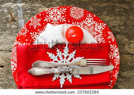 Christmas serving with red snowflake ornament plate and candle, with other christmas decorations - stock photo