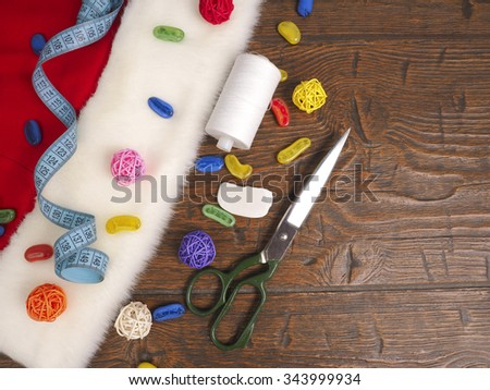 Christmas sewing still life includes fabric and craft supplies for creating festive decorations and ornaments. - stock photo
