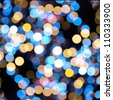 Christmas shiny light bokeh in  blue and yellow colors - stock photo