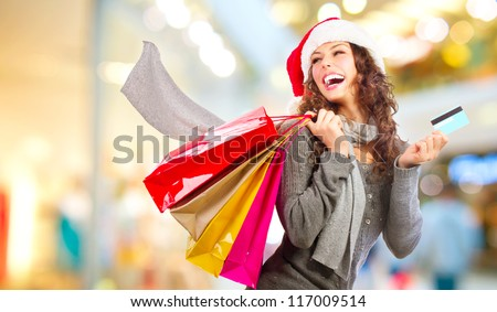Christmas Shopping. Beautiful Happy Girl With Credit Card In Shopping Mall. Shopping Bags. Shopping Center. Christmas Sales - stock photo