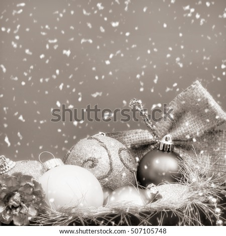 Christmas shopping concept with decorations in bag in snowfall, vintage toned