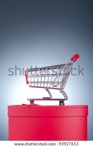 Christmas shopping concept with shopping cart - stock photo