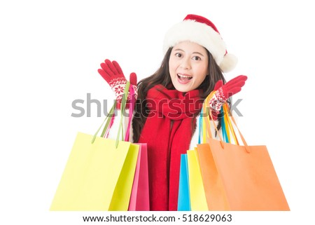 Christmas shopping woman surprised face. carrying colorful shopping bags for gifts. isolated on white background.