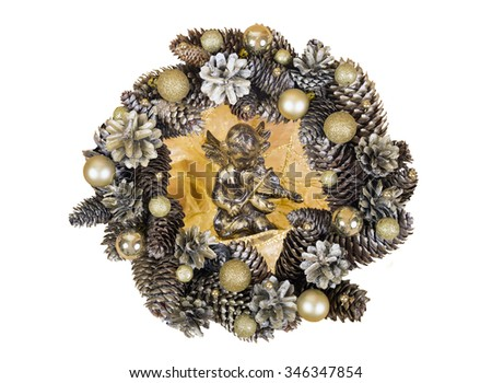 Christmas silver angel on wooden surface with wreath of cones isolated on white background. - stock photo