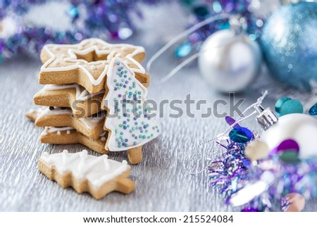 Christmas Silver background with decoration and gingerbread cookies. - stock photo