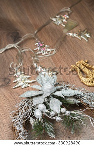 Christmas silver wreath on the wooden background - stock photo