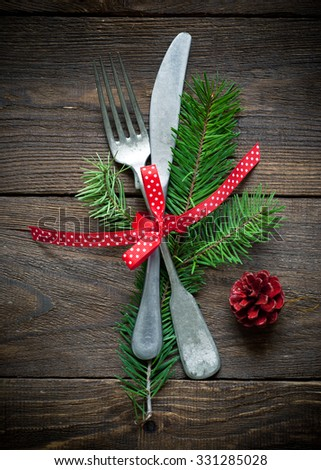 Christmas silverware at dark wooden table. Top view. - stock photo