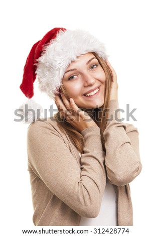 Christmas smiling girl, young woman in santa hat  - stock photo