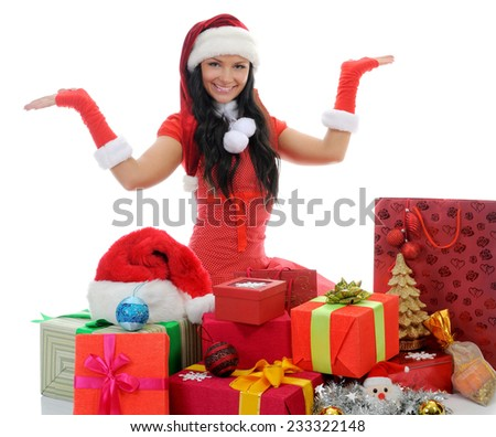 Christmas smiling woman in red christmas cap with a gift. isolated on a white background - stock photo