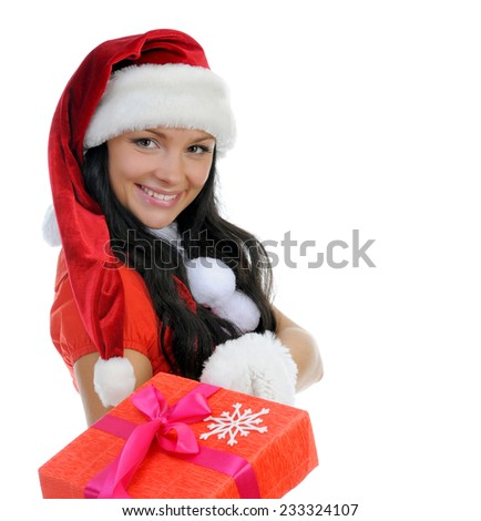 Christmas smiling woman in red christmas cap with a gift. isolated on a white background